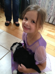 Our daughter with one of the puppies.